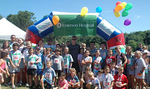 Race Participants with Lincoln Kids Triathlon Inflatable Arch