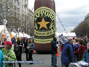 Inflatable Sapporo Beer Bottle Displayed at Cherry Blossom Festival