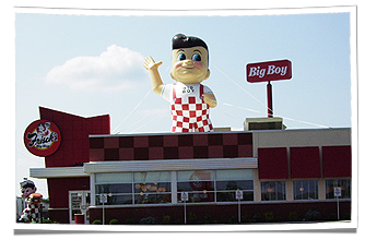 Frisch's Inflatable Big Boy Mascot Displayed on Restaurant Rooftop