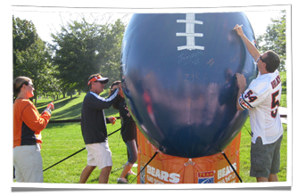 Athletes Signing TEAM Coalition's Custom Inflatable Football