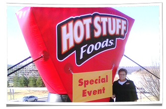Inflatable Hot Stuff Foods Logo at Marketing Event