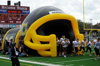 East Central Hornets' Inflatable Football Helmet Tunnel at Home Game