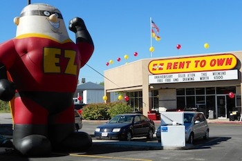 Inflatable Captain EZ Mascot at E-Z Rent to Own Retail Location